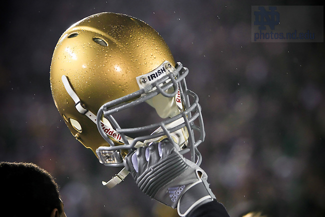 Nov. 17, 2007; South Bend, IN, USA; ND Football players hold up their helmets after beating Duke at ND Stadium.