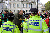 Environmental activists from Extinction Rebellion protesters being arrested after being un-glued in London on 09 October 2019 in London, England.<br /> .<br /> Protesters plan to blockade the London government district for a two week period, as part of 'International Rebellion' taking place in over 60 cities around the world, calling for decisive and immediate action from governments in the face of climate and ecological emergency. <br /> .<br />  Photo by Alan  Stanford.