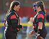 Claudia Porcaro #13, Plainedge catcher, left, and pitcher Victoria Nowak #17 have a laugh as they look to work out of a jam in the top of the fifth inning of a Nassau County varsity softball game against Island Trees at Schwarting Elementary School in North Massapequa on Monday, May 1, 2017. Plainedge won by a score of 10-5.