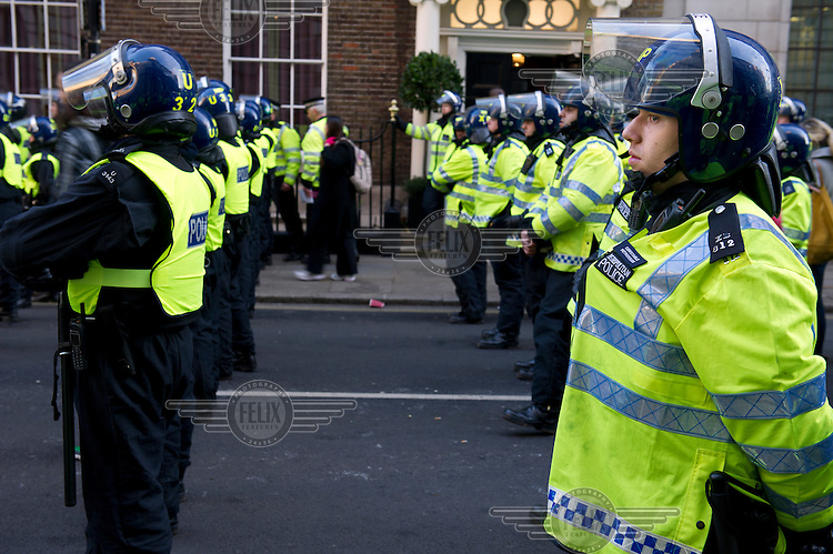 Riot police wait near Parliament Square during a demonstration by students against the government's proposed increase in university tuition fees.