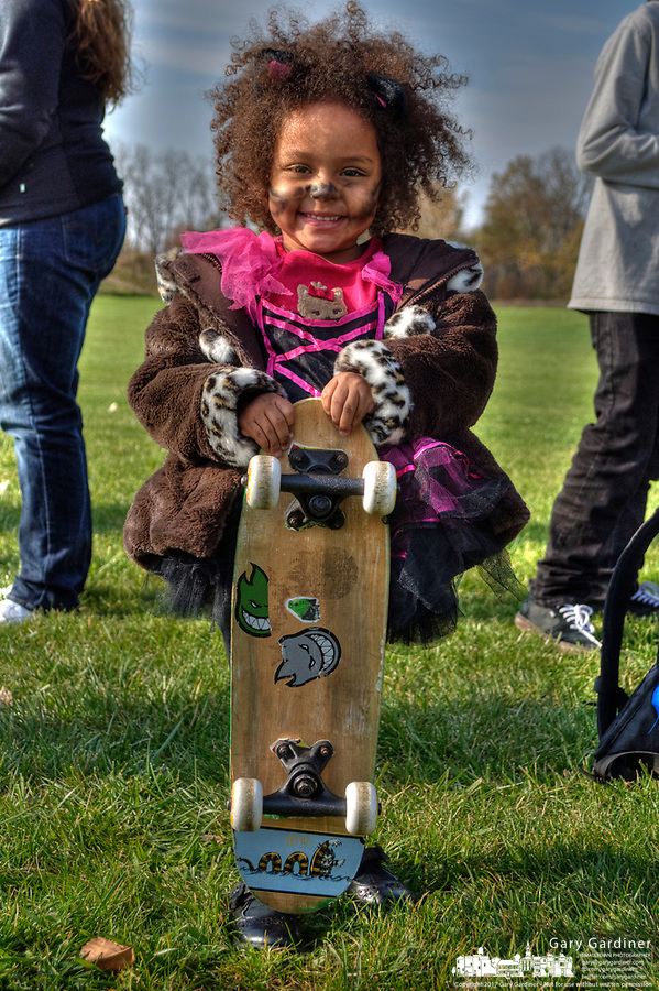 Young skateboarder with skateboard dressed in costume at Halloween skateboarding event at Westerville Skate Park.