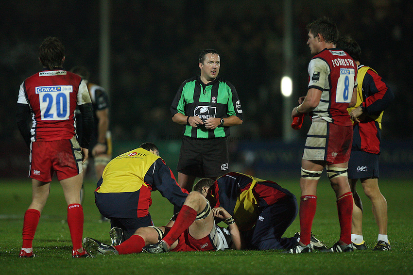 Photo: Rich Eaton...Worcester Warriors v Gloucester Rugby. Guinness Premiership. 13/10/2006. referee Dave Pearson holds up play whilst an injured player is tended to