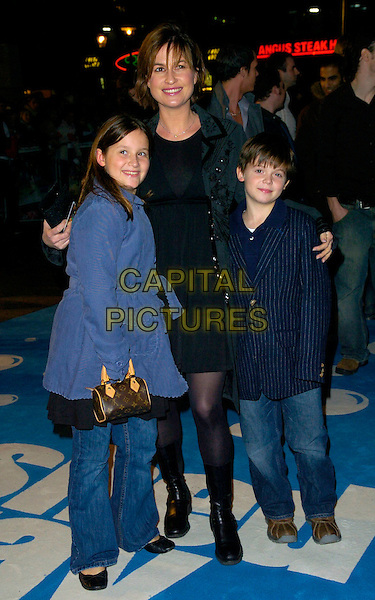 "EMMA FORBES & GUESTS.The premiere of ""Flushed Away"" at the Empire, Leicester Square, London, UK..November 23rd, 2006.full length blue coat pinstripe jacket black boots.CAP/CAN.©Can Nguyen/Capital Pictures"