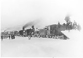 Wedge-plow equipped D&amp;RG #405 with flanger leading a three-engine passenger train into Leadville in a winter scene.<br /> D&amp;RG  Leadville, CO