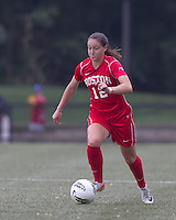 Boston University midfielder Jessica Luscinski (12) brings the ball forward. After 2 complete overtime periods, Boston College tied Boston University, 1-1, after 2 overtime periods at Newton Soccer Field, August 19, 2011.