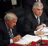 Washington, DC - April 8, 2004 -- 9/11 Commission member Fred Fielding reads his notes, left, as his fellow commission member Richard Ben-Veniste, right,  questions Doctor Condoleezza Rice, National Security Advisor, during her testimony before the Commission in Washington, D.C. on April 8, 2004.<br /> Credit: Ron Sachs / CNP<br /> [RESTRICTION: No New York Metro or other Newspapers within a 75 mile radius of New York City]
