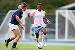 25 September 2011: North Carolina's Crystal Dunn (19) is defended by Virginia's Amanda Fancher (left). The University of Virginia Cavaliers defeated the University of North Carolina Tar Heels 1-0 in overtime at Fetzer Field in Chapel Hill, North Carolina in an NCAA Division I Women's Soccer game. UNC players wore special pink jerseys for the game to be auctioned off as part of a fundraiser for the UNC Lineberger Comprehensive Cancer Center.