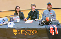 Westside Eagle Observer/SUSAN HOLLAND<br /> Caleb Brown smiles after signing Thursday, March 5, to run track and play football for the Warriors at Hendrix College in Conway this fall. Caleb was accompanied by his mother, Cielito Brown, and his father, James Brown. Caleb had set a new school record in the 110-meter hurdles in a track meet at Fayetteville just the night before.