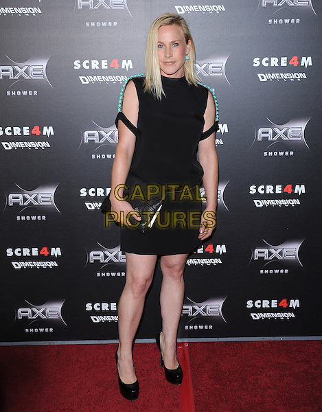PATRICIA ARQUETTE .at the Weinstein World Premiere of 'Scream 4' held at The Grauman's Chinese Theatre in Hollywood, California, USa, April 11th 2011..full length dress cut out sleeves clutch bag shoes black turquoise beaded shoulders platform .CAP/RKE/DVS.©DVS/RockinExposures/Capital Pictures.