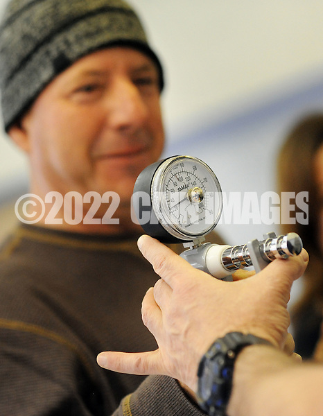 Lower Bucks Hospital's Jay Witkowski, right, checks the strength level of Everard Perez during a Health Fair sponsored by Lower Bucks Hospital  and held at St. Mark's School Hall Sunday March 13, 2016 in Bristol, Pennsylvania. (Photo by William Thomas Cain)