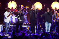 NASHVILLE, TN - JUNE 5: Shawn Stockman, Nathan Morris and Wanya Morris of Boyz II Men and Brett Young (C) perform on the 2019 CMT Music Awards at Bridgestone Arena on June 5, 2019 in Nashville, Tennessee. (Photo by Frederick Breedon/PictureGroup)
