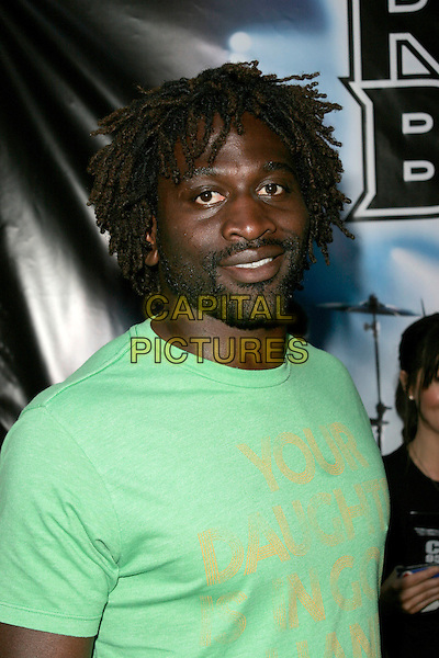 "PAUL SACKEY.""Rock Band"" video game launch at Bloomsbury Bowling Lanes, London, England. .May 13th, 2008.half length green t-shirt .CAP/AH.©Adam Houghton/Capital Pictures."
