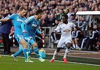 SWANSEA, WALES - FEBRUARY 07: Nathan Dyer of Swansea (R) against two Sunderland players during the Premier League match between Swansea City and Sunderland AFC at Liberty Stadium on February 7, 2015 in Swansea, Wales.