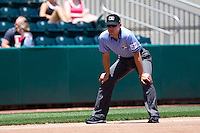 Third Base Umpire Jimmy Volpi looks down the line during a game between the San Antonio Missions and the Springfield Cardinals on May 30, 2011 at Hammons Field in Springfield, Missouri.  Photo By David Welker/Four Seam Images.