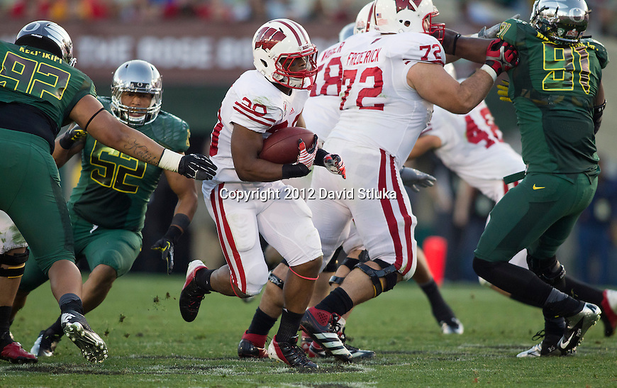 Wisconsin Badgers running back James White (20) carries the ball during the 2012 Rose Bowl NCAA football game against the Oregon Ducks in Pasadena, California on January 2, 2012. The Ducks won 45-38. (Photo by David Stluka)
