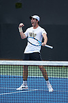 Ian Dempster of the Wake Forest Demon Deacons celebrates after winning a point during #3 doubles against the Texas A&M Aggies during the semifinals at the 2018 NCAA Men's Tennis Championship at the Wake Forest Tennis Center on May 21, 2018 in Winston-Salem, North Carolina. The Demon Deacons defeated the Aggies 4-3. (Brian Westerholt/Sports On Film)