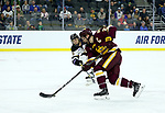 SIOUX FALLS, SD - MARCH 23: Karson Kuhlman #20 from Minnesota Duluth pushes the puck past Riese Zmolek #25 from Mankato during their game at the 2018 West Region Men's NCAA DI Hockey Tournament at the Denny Sanford Premier Center in Sioux Falls, SD. (Photo by Dave Eggen/Inertia)