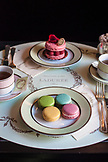 FRANCE, Paris, Table set up in Laduree with plate of macarons and Rasberry Cake