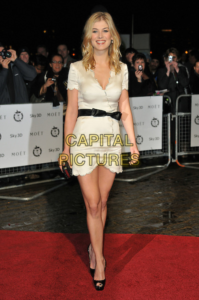 ROSAMUND PIKE.London Critics' Circle Film Awards at BFI Southbank, London, England..February 10th 2011.ALFS full length black dress white wrap belt peep toe shoes .CAP/CAS.©Bob Cass/Capital Pictures.