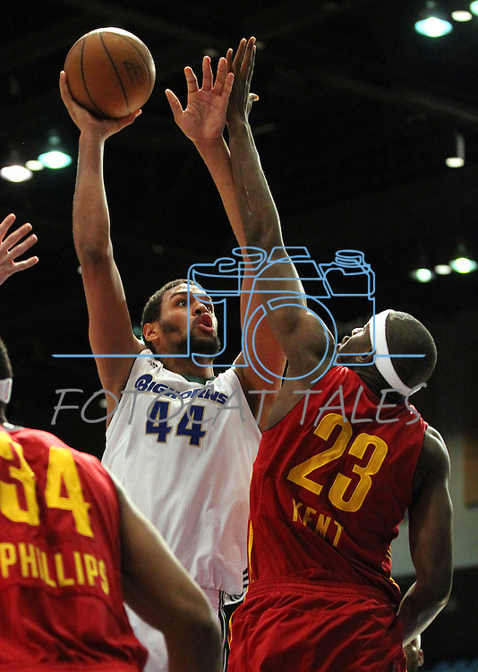 Patrick O'Bryant of the Reno Bighorns makes a shot over Fort Wayne Mad Ants defender Anthony Kent in Friday night's minor league basketball game, Feb. 11, 2011, at the Reno Events Center in Reno, Nev. .Photo by Cathleen Allison