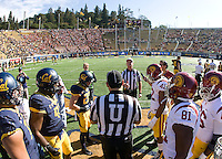 California and USC captains watch referee Terry Leyden tosses a coin before NCAA football game at Memorial Stadium in Berkeley, California on November 9th, 2013.   USC defeated California, 62-28.