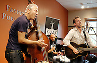 NWA Democrat-Gazette/DAVID GOTTSCHALK  Jimmy Sutton (from left), Jason Smay and JD McPherson, members of the band JD McPherson, play during a live broadcast of Ozarks at Large on   KUAF Public Radio Friday, August 28, 2015 at the Fayetteville Public Library. The broadcast featured artist and performances involved with the Fayetteville Roots Festival. The 6th annual festival is a four day event featuring two dozen performances at a variety of location in Fayetteville and food offerings that also include a chef's competition today at the Fayetteville Farmers Market.