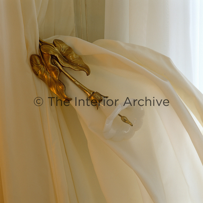 In the Duchess of Windsor's bathroom the curtain tie-backs are in the form of gilded arum lilies