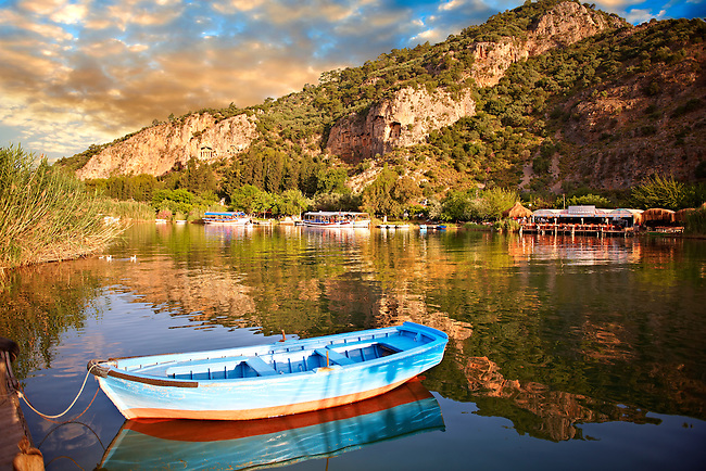 Ferry row boat on the Dalyan Çay River looking towards boats & fish restaurant. Mediterranean coast Turkey