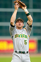Shortstop Landis Ware #5 of the Baylor Bears makes a catch in shallow left field against the Houston Cougars at Minute Maid Park on March 4, 2011 in Houston, Texas.  Photo by Brian Westerholt / Four Seam Images