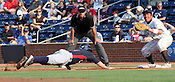 Nolan Fontana slides back to first in Game 3 of the annual Collegiate Friendship Series between Team USA and Japan on Tuesday, July 5, 2011. Photo by Al Drago.