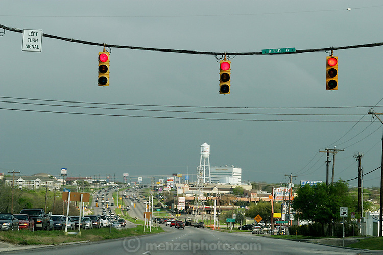 Red lights and darkening sky in San Antonio, Texas. (Supporting image from the project Hungry Planet: What the World Eats.)