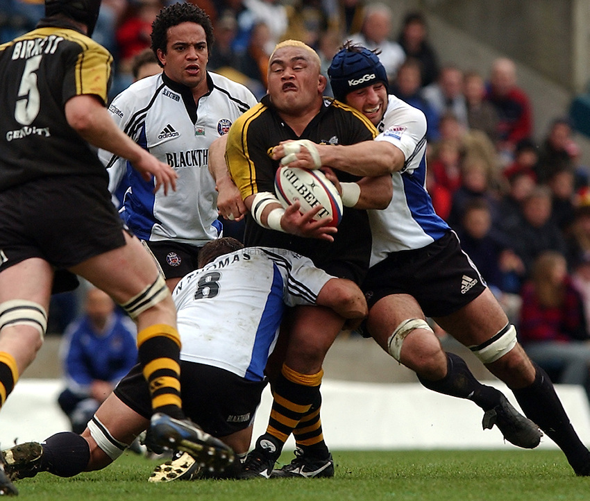Photo: Richard Lane..London Wasps v Bath Rugby. Zurich Premiership.  06/04/2003..Trevor Leota is tackled by Danny Grewcock.