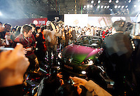 Chinese and foreign media surrounds a newly launched MG  model at the Nanjing MG Automibile Corporation plant in Nanjing, China. The Chinese company is now in a position to take on Rover's assets and plan its future. It intended to relocate the engine plant and some car production plant to China but to retain some car production plant in the UK..27 Mar 2007