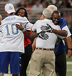 Plenty of hugs to go around before the coin toss by Jackie Joyner Kersee (shown here hugging Marc Bulger, at left). At right Dick Vermeil gets a big hug from Isaac Bruce.