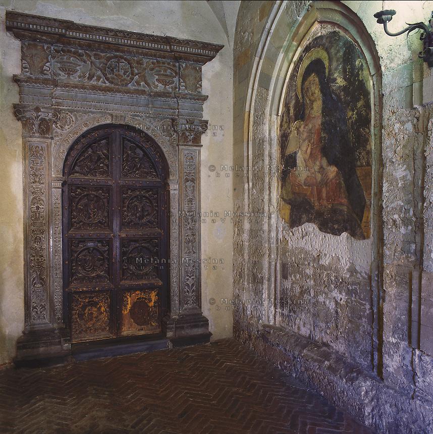 Palermo, Magione basilica,12th century, the cloister, marble portal and fresco.<br /> Palermo, basilica della Magione, XII sec, il chiostro, portale marmoreo e affresco.