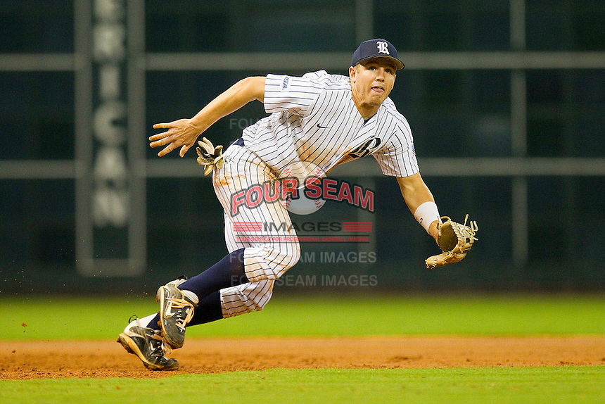 Third baseman Shane Hoelscher #2 of the Rice Owls breaks to his left in pursuit of a ground ball against the Texas A&M Aggies at Minute Maid Park on March 5, 2011 in Houston, Texas.  Photo by Brian Westerholt / Four Seam Images