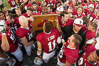 Stanford, CA -- November 23, 2013:  Stanford's Shayne Skov kisses the Axe after defeating Cal 63-13 at Stanford Stadium.