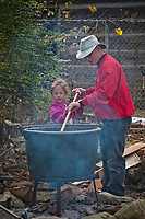Ainsley Gallagher, 6, learns how to stir apple butter begin cooked at the annual Ned Mosher Apple Butter Festival. The festival held at the Knox-Metzker log cabin on the grounds of McVay Elementary School in Westerville every year helps raise money to maintain the cabin as a teaching tool for students at the school.