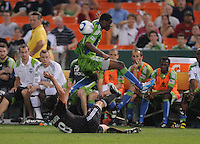 DC United defender Devon Mctavish (18) slides to defend the play against Seattle Sounders midfielder Steve Zakuani (11).  Seattle Sounders. defeated DC United 1-0 at RFK Stadium, Thursday July 15, 2010.