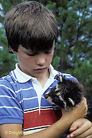 MA25-071z  Boy with raccoon.