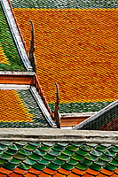 Pattern in ceramic tiles on overlapping rooftops, Wat Pho, Bangkok, Thailand