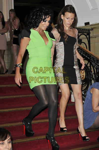 Nancy Dell'Olio.Arrivals at the Luxury and Lifestyle Awards, Porchester Hall, London, England..March 17th 2012.full length black green dress cleavage bows shoulder christian louboutin shoes bag stairs steps looking down walking .CAP/MAR.© Martin Harris/Capital Pictures.