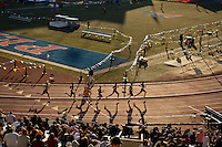 Athletes compete in the College Men's Sprint Medley Championship of America Friday evening as the sun gets close to setting on Franklin Field at the 2013 Penn Relays.