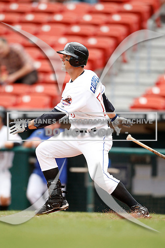 May 28, 2009:  Pinch Hitter Jason Cooper of the Buffalo Bisons follows through while at bat during a game at Coca-Cola Field in Buffalo, NY.  The Bisons are the International League Triple-A affiliate of the New York Mets.  Photo by:  Mike Janes/Four Seam Images