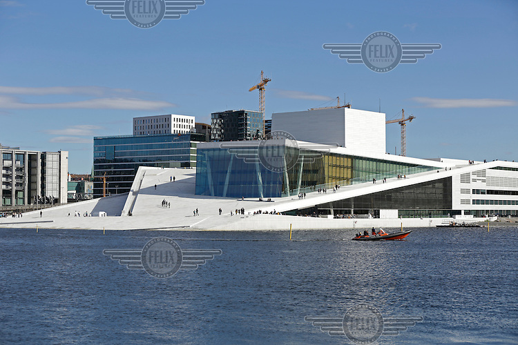 The Oslo Opera House (Norwegian: Operahuset) is the home of The Norwegian National Opera and Ballet, and the national opera theatre in Norway. The building is situated in the Bjørvika neighborhood of central Oslo, at the head of the Oslofjord.