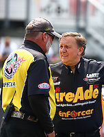 Jun 21, 2015; Bristol, TN, USA; NHRA pro stock driver Larry Morgan (right) talks with official starter Mark Lyle during the Thunder Valley Nationals at Bristol Dragway. Mandatory Credit: Mark J. Rebilas-