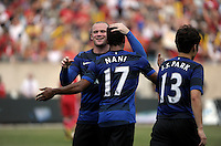 Manchester United midfielder Nani (17) gets a hug from teammate Wayne Rooney (10) after scoring Manchester United's third goal.  Manchester United defeated the Chicago Fire 3-1 at Soldier Field in Chicago, IL on July 23, 2011.