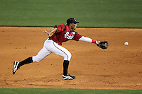 Nashville Sounds second baseman Eric Farris #5 flips the ball to first during a game against the Omaha Storm Chasers at Greer Stadium on April 25, 2011 in Nashville, Tennessee.  Omaha defeated Nashville 2-1.  Photo By Mike Janes/Four Seam Images