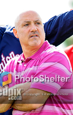 25 February 2012: Washington Nationals' General Manager Mike Rizzo watches his players during the first full squad Spring Training workout at the Carl Barger Baseball Complex in Viera, Florida. Mandatory Credit: Ed Wolfstein Photo