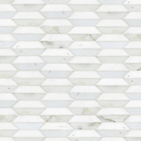 Fairfax 1, a hand-cut stone mosaic shown in Thassos and honed Calacatta Tia, is part of the Silk Road® collection by New Ravenna.